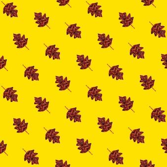 Jesienny wzór-żółty z jesiennymi liśćmi z dzianiny szalikowej.