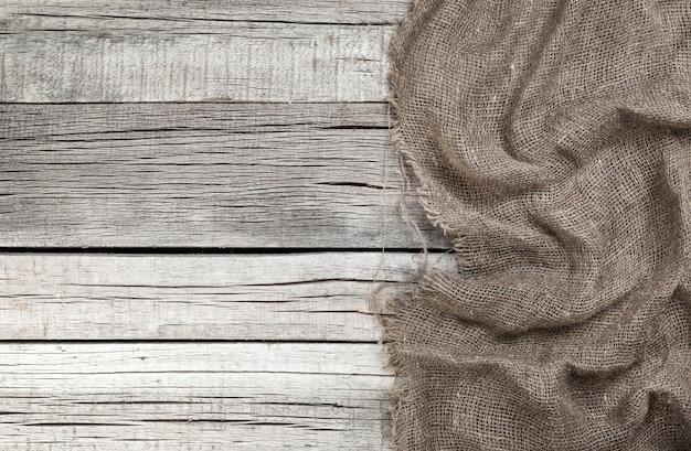 Juta na starym szarym drewnianym tle