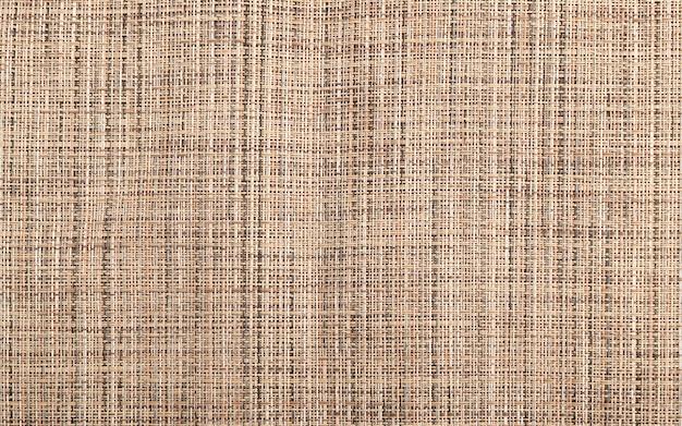Juta tekstura tło. stary wzór płótna lnianego, tkanina lniana, imitacja słomy rattanowej