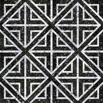 Kafelki podłogowe. naturalne czarne i białe płytki marmurowe. wzór geometryczny