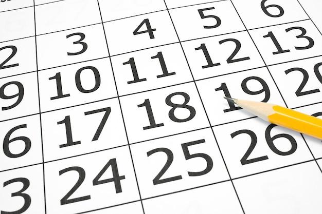 Kalendarz luty z zawinięciem strony na białym tle