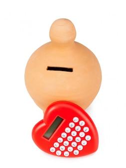 Kalkulator i smoczek w kształcie serca.