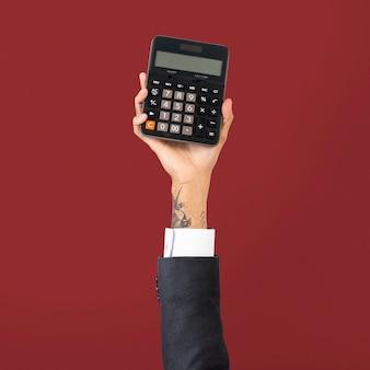 Kalkulator ręki trzymającej w koncepcji finansów