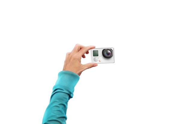 Kamera akcji w ręku na białym tle