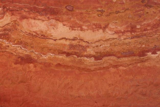 Kamień naturalny koloru czerwonego, trawertyn koloru czerwonego z żyłkami.
