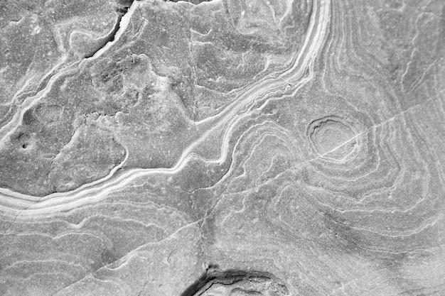Kamień tekstura tło abstrakcyjny wzór na powierzchni szarej skały