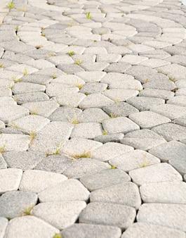 Kamienna kostka brukowa koło tekstury. streszczenie strukturalne tło wzór płyt chodnikowych nowoczesnych ulic