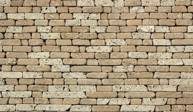 Kamienna ściana Lub Tło, Z Naturalnej Skały Z Miękkiej Skały, Typu Osadowego. Tekstura Szary Trawertyn. Premium Zdjęcia