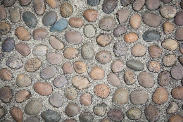 Kamienna ściana powierzchnia z cementowym tłem