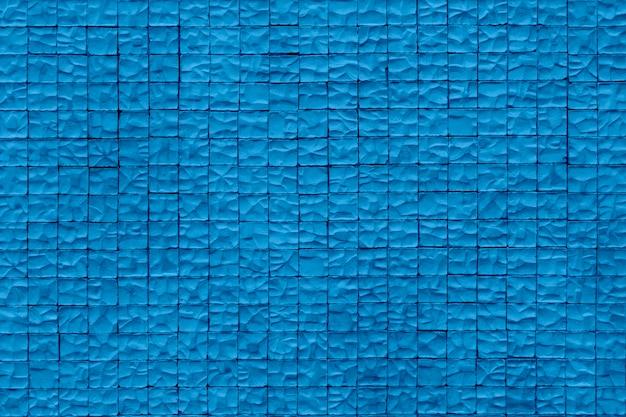 Kamienna ściana . starzejący się piaska kamienny mur dla tekstury i projekta tła. modny niebieski kolor roku.