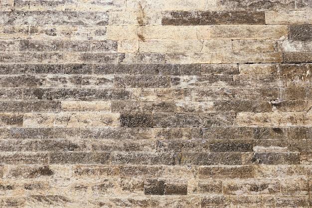 Kamienna ściana. tekstura kamienia. płaskie kamienie konstrukcyjne.