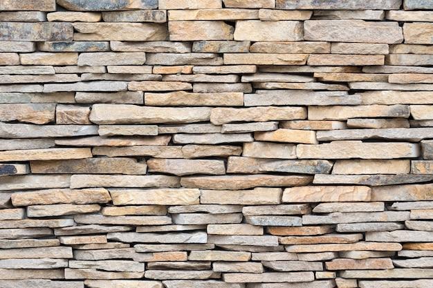 Kamienna ściana z kamieni naturalnych. brickwall tekstura tło