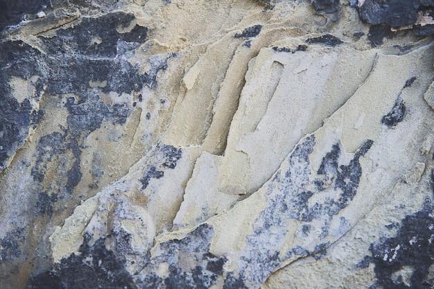 Kamienna tekstura tło. ciężka stara malująca ściana w grunge stylu. zamknąć widok
