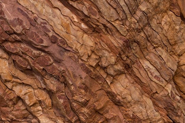 Kamienna tekstura w kolorach czerwonym i brązowym. tło