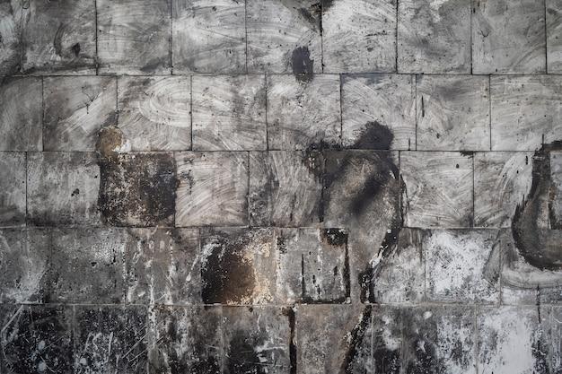 Kamienna tekstura ze starą tablicą
