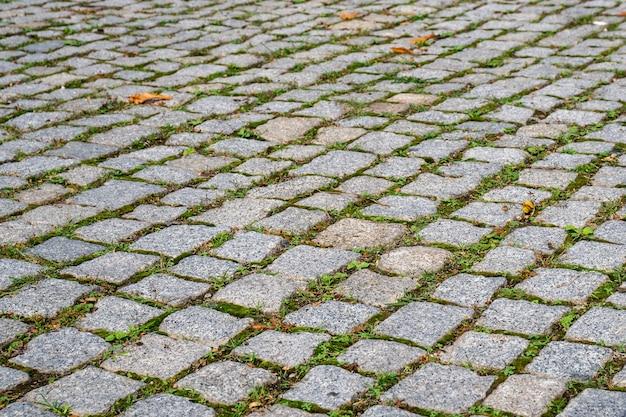 Kamienny blok tekstura, droga dla pieszych. ulica.