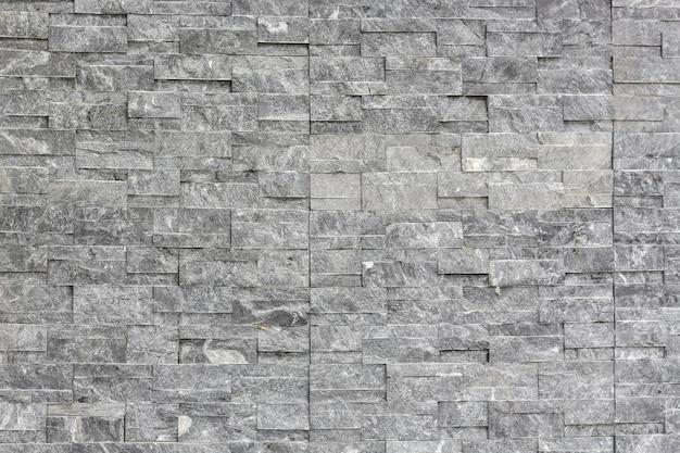 Kamienny ceglany kij w ścianie jako tło tekstura