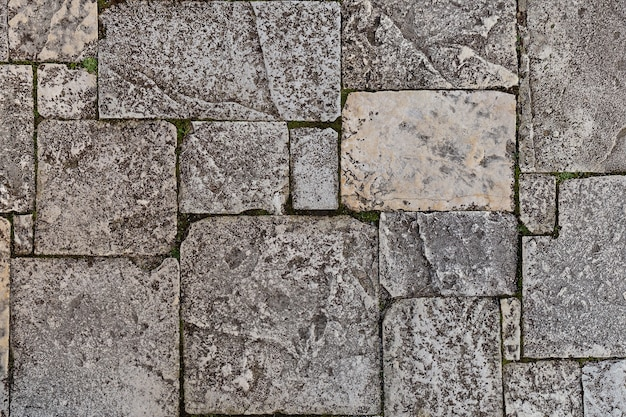 Kamienny mur tekstura tło zdjęcie. kamienna ściana jako tło lub tekstura, naturalny kolor.
