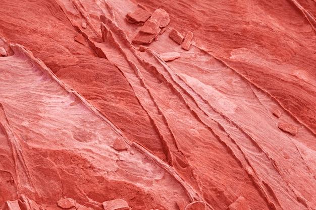 Kamienny tło i tekstura w koralowym kolorze - wizerunek