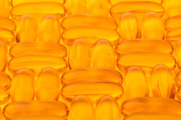 Kapsułki z olejem rybim omega 3. tło, tekstura