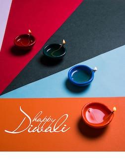 Kartka z życzeniami szczęśliwego diwali lub szczęśliwego deepavali wykonana przy użyciu zdjęcia diya lub lampy naftowej