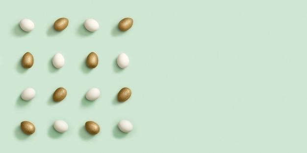 Kartkę z życzeniami lub baner z zdobionymi złotymi i białymi jajkami wielkanocnymi na zielonym tle. wesołych świąt wzór.