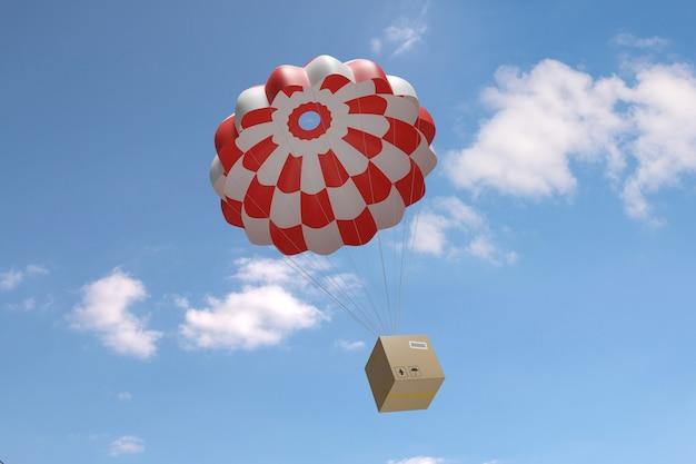 Karton opadający spadochronem po błękitnym niebie