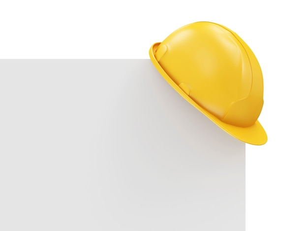 Kask budowlany na białej pustej tablicy na białym tle