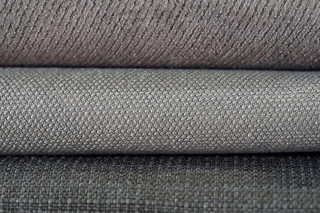 Katalog wielobarwnych tkanin z matowego tła tekstury tkaniny, tekstury tkaniny jedwabnej, tła przemysłu tekstylnego z rozmytym, kolorowa tkanina bawełniana, makro, katalog bibułek