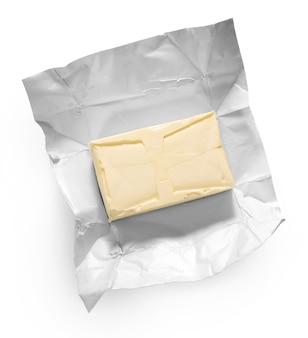 Kawałek masła na białym tle widok z góry
