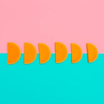Kawałki dyni raw vegan minimalistyczny styl artystyczny