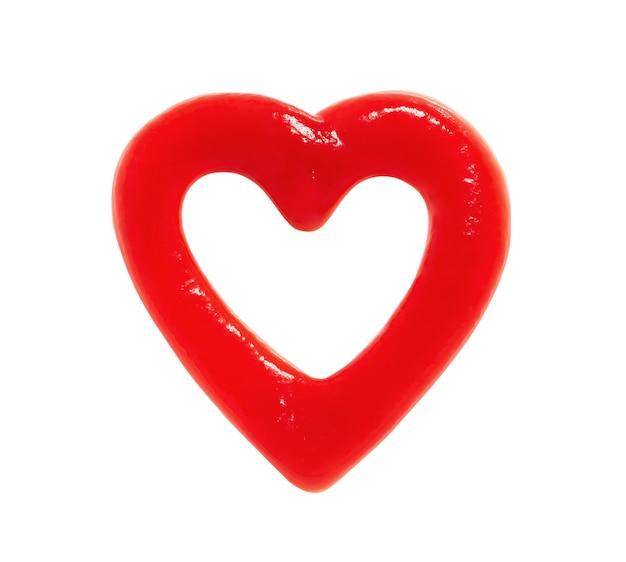 Ketchup w formie serca, symbol miłości na białym tle