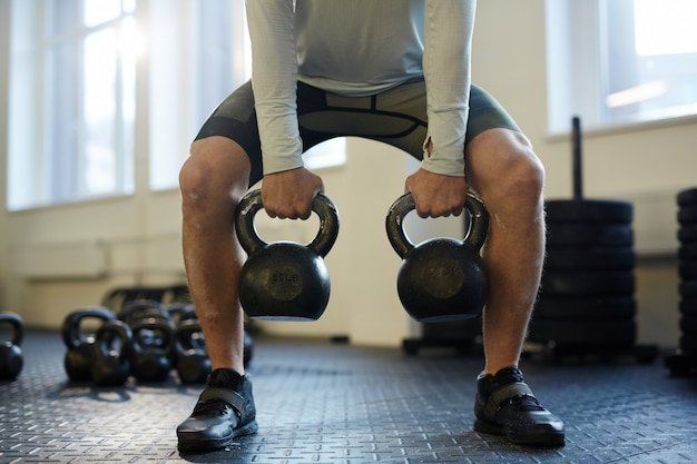 Kettlebell lifting in gym
