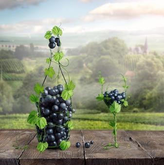 Kieliszek i butelka wina z winorośli na starym drewnianym stole
