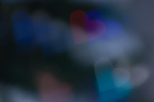 Kierowy kształta bokeh światła tło, miłości walentynki ślubny pojęcie