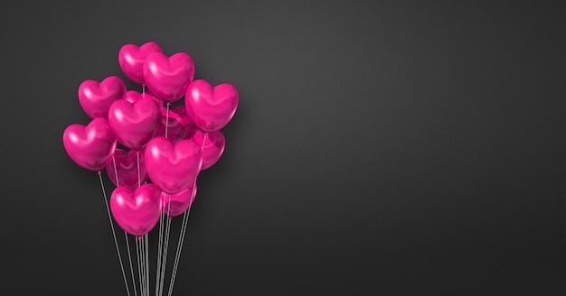 Kilka balonów kształt różowego serca na tle czarnej ściany. baner poziomy. renderowanie ilustracji 3d