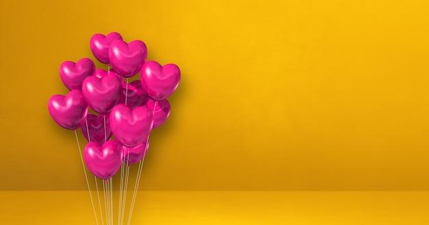 Kilka balonów kształt różowego serca na tle żółtej ściany. baner poziomy. renderowanie ilustracji 3d