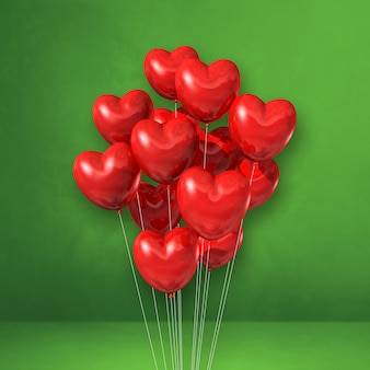 Kilka balonów kształt serca czerwonego na tle bgreen ściany. renderowanie ilustracji 3d