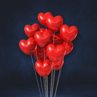 Kilka balonów kształt serca czerwony na tle czarnej ściany. renderowanie ilustracji 3d