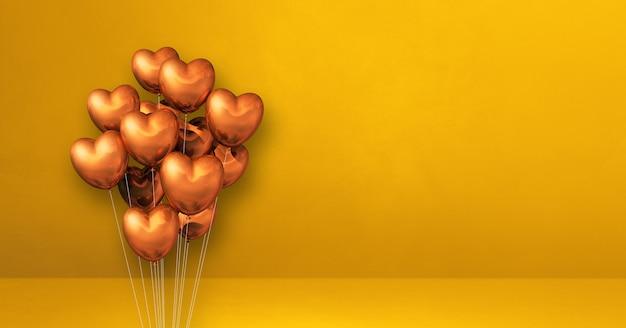 Kilka balonów kształt serca miedzi na tle żółtej ściany. baner poziomy. renderowanie ilustracji 3d