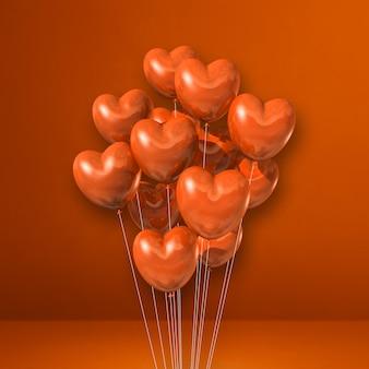 Kilka balonów kształt serca na tle pomarańczowej ściany. renderowanie ilustracji 3d