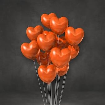 Kilka balonów kształt serca pomarańczowy na tle czarnej ściany. renderowanie ilustracji 3d