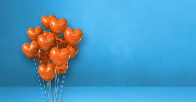 Kilka balonów kształt serca pomarańczowy na tle niebieskiej ściany. baner poziomy. renderowanie ilustracji 3d