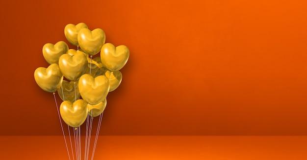 Kilka balonów kształt żółtego serca na tle pomarańczowej ściany. . renderowanie ilustracji 3d