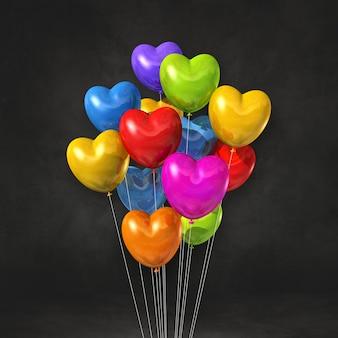 Kilka balonów w kształcie serca kolorowe na czarnej ścianie. renderowanie ilustracji 3d