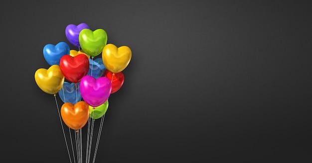 Kilka balonów w kształcie serca kolorowe na tle czarnej ściany. . renderowanie ilustracji 3d