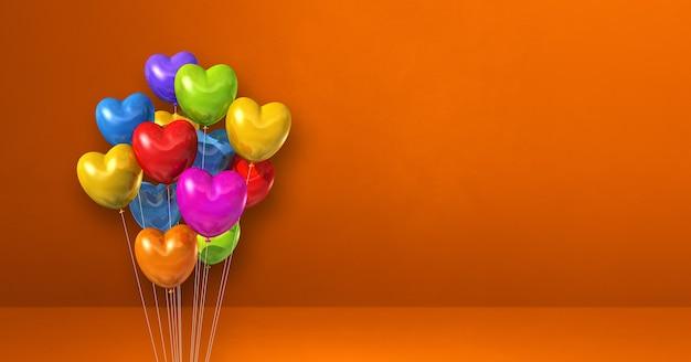 Kilka balonów w kształcie serca kolorowe na tle pomarańczowej ściany. baner poziomy. renderowanie ilustracji 3d