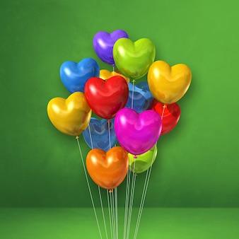 Kilka balonów w kształcie serca kolorowe na tle zielonej ściany. renderowanie ilustracji 3d