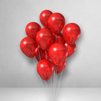 Kilka czerwonych balonów na tle białej ściany. renderowanie ilustracji 3d