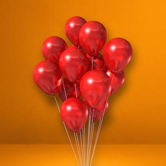Kilka czerwonych balonów na tle pomarańczowej ściany. renderowanie ilustracji 3d